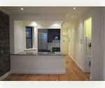 Renovated One Bedroom Apartment in Elevator Buidling with Laundry in the unit!