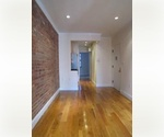 Amazing 2 bedroom on a most fun East Village block. Features W/D, exposed brick and all modern kitchen!