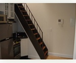 Terrific 1 bedroom penthouse duplex with an additional sleep loft