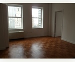 EXTREMELY BRIGHT AND SUNNY UNIT WITH AMAZING UNOBSTRUCTED VIEWS IN THE FINANCIAL DISTRICT - NO FEE