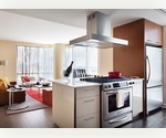 NO FEE - Double corner 2 Bedroom, 2 Bathroom apartment with beautiful, open northeast views, floor-to-ceiling windows and an in-home washer and dryer.