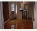 Renovated one bedroom with dishwasher, exposed brick, and marble bath in West Village