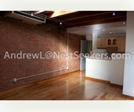 Dreamy SOHO Loft // Sunny Corner Unit with Skylight // Exposed Brick and High Ceilings // Washer-Dryer