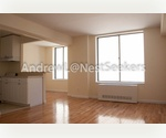 NoHo Loft-like Alcove Studio // Sun Drenched and Extra Closet Space // Doorman with Laundry