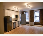 West Village loft-like Alcove Studio // High End Renovations // Exposed Brick